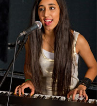 Girl playing keyboards and singing